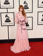Florence Welch was all about whimsical glamour at the Grammys in a pink Gucci ruffle gown with star, moon, and dragonfly beading.