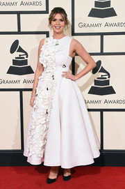Carly Steel sweetened up the Grammys red carpet with this flower-appliqued fit-and-flare dress by Gauri and Nainika.