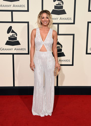 Kaley Cuoco went for some '70s flair in a sequined jumpsuit with a midriff cutout during the Grammys.