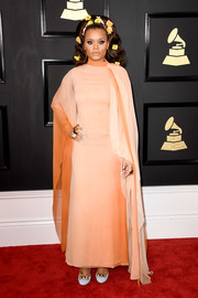 Andra Day went for a vintage Dior gown in gradients of peach and orange when she attended the 2017 Grammys.