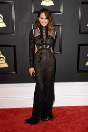 Chrissy Teigen looked va-va-voom (as always) in a sheer, strappy cutout gown by Roberto Cavalli at the 2017 Grammys.