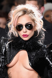 Lady Gaga topped off her look with a pair of Ray-Ban aviators.