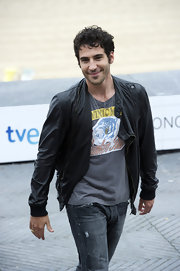 Miguel Angel Silvestre wore a black leather jacket with his jeans and tee for a ruggedly handsome look.
