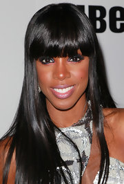Kelly Rowland intensified her look with thick, dark lashes and carefully lined eyes. She kept things playful by also lining her eyes with a bright pink shadow to keep the look flirty and fun.