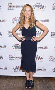 Sheryl Crow kept it simple in a sleeveless navy dress with a fluted hem during the African Children's Choir Gala.