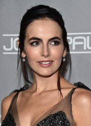 Camilla Belle was punk-glam at the Baby2Baby Gala wearing this messy bun.