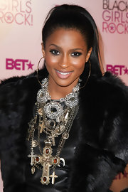 Ciara knows how to step-up her look with loads of layered necklaces. Although, it may be a little to overwhelming when paired with her fur jacket.