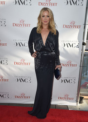 Christina Applegate polished off her sleek ensemble with a black Rodo clutch.