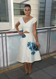 Iridescent silver pumps added a futuristic feel to Emmanuelle Chriqui's ladylike look.