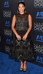 Gina Rodriguez looked absolutely darling in a tea-length black Reem Acra dress with ornate silver embellishments during the Critics' Choice Television Awards.