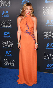 Cat Deeley went for a classic silhouette in this orange Azzaro Couture halter gown with purple feather detailing during the Critics' Choice Television Awards.
