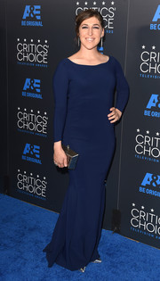 Mayim Bialik went for simple elegance in a long-sleeve navy column dress during the Critics' Choice Television Awards.
