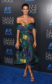 For her Critics' Choice Television Awards look, Angie Harmon opted for a Christian Siriano off-the-shoulder dress in a gorgeous blend of green, purple, and yellow.