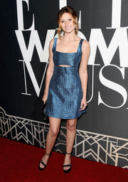 Alyson Michalka completed her look with a pair of black ankle-strap platform sandals.