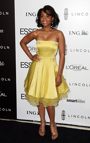Anika Noni Ross was all smiles in this sunshine yellow strapless number at the Essence Luncheon.