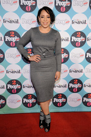 Selenis Leyva styled her dress with chunky two-tone peep-toe boots.