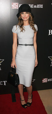 AnnaLynne topped off her eclectic red carpet look with black peep-toe sandals.