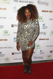 Serena Williams teamed a leopard-print mini dress with Tina Turner hair for her wild red carpet look at the Imagine Ball.