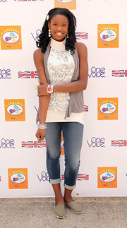 Coco Jones stayed cozy and stylish in a glitzy sleeveless turtleneck with fun sequin prints at the Kidstock Music and Arts Festival.