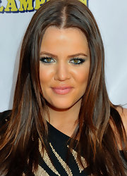 Khloe added a little glimmer to her look with metallic silver shadow and lightly lined eyes. Blush tone lipstick completed her look.