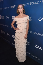 Suki Waterhouse looked refined in an off-the-shoulder ruffled gown.