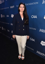Lana Del Rey looked polished with a navy button blazer over her white pants at the Help Haiti Home Gala.
