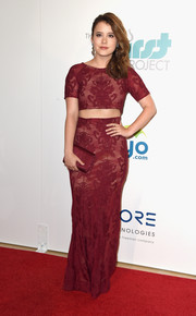 Taylor Spreitler topped off her monochromatic ensemble with a Lauren Merkin satin clutch.