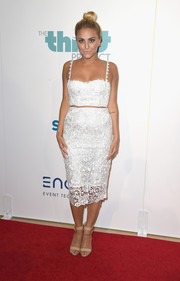 Cassie Scerbo teamed her crop-top with a matching white lace pencil skirt.