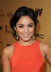 Vanessa Hudgens attended the 5th Annual Women in Film pre-Oscar party wearing a pair of false lashes and shimmering silver eyeshadow.