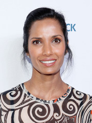 Padma Lakshmi swept her tresses back into a casual side-parted updo for the Women in the World Summit.