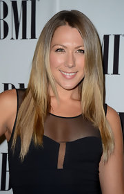 Colbie Caillat arrived at the BMI Pop Awards wearing her sleek hair long and straight.