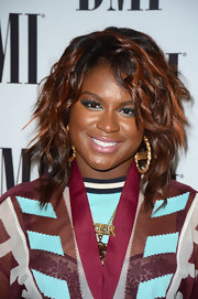 Ester Dean wore bright shimmering aqua eyeliner and extra-long false lashes at the BMI Pop Awards.