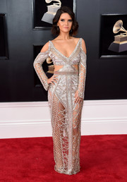 Maren Morris hit the Grammys red carpet rocking a see-through silver cutout gown by Julien Macdonald.