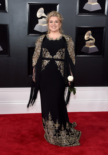 Kelly Clarkson looked downright regal at the 2018 Grammys in a black Christian Siriano gown with fringed sleeves and ornate gold embroidery.