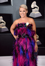 Pink paired a multicolored beaded clutch with a feathered gown for a totally vibrant look during the 2018 Grammys.