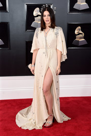 Lana Del Rey paired her dress with silver cross-strap platforms, also by Gucci.