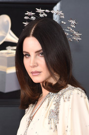 Lana Del Rey looked totally enchanting wearing this silver and crystal star headpiece by Gucci.