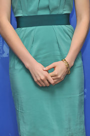 Greta Gerwig accessorized with a chic gold link bracelet when she attended the 'Greenberg' photocall at the Berlin Film Festival.