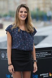 Amaia Salamanca tucked her top into a short black skirt at a photocall.