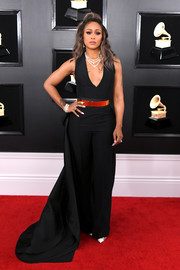 Eve was edgy-glam at the 2019 Grammys in a black Ashi Studio X AlOthman jumpsuit with a gold belt and an attached train.