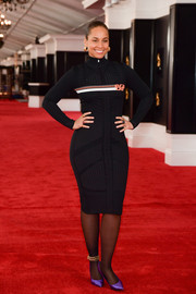 Alicia Keys was sporty-sexy in a fitted black turtleneck dress by Prada at the Grammy Awards red carpet roll out.