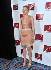 "Scarlet wore a scalloped peach cocktail dress with a pair of perforated, cutout, nude ""Butterfly"" booties."