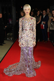 Andrea Riseborough looked enchanting in a floor-sweeping flower-embroidered gown by Ralph & Russo Couture at the BFI London Film Festival Awards. The purple Balenciaga boots underneath were an unexpected but welcome surprise!