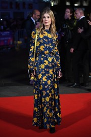 Rosamund Pike went for a demure blue and yellow floral maxi dress by Altuzarra when she attended the BFI London Film Festival Awards.
