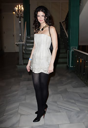 Shermine Shahrivar wore a pair of plain black tights under her short dress.