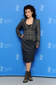 Helena Bonham Carter paired her gray skirt suit with matching suede lace up boots.