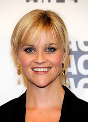 Reese Witherspoon wore her hair in a classic ponytail with long wispy bangs while attending the 62nd Annual ACE Eddie Awards.