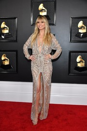 Heidi Klum coordinated her dress with a pair of strappy gold heels by Giuseppe Zanotti.