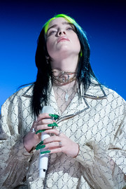 Billie Eilish performed at the 2020 Grammys wearing an eye-catching diamond choker.