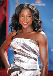Rutina showed off her long curls while hitting the Emmy Awards red carpet.